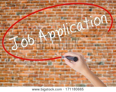 Woman Hand Writing Job Application With Black Marker On Visual Screen