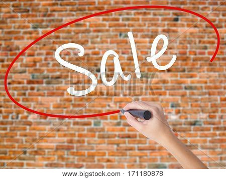 Woman Hand Writing Sale With Black Marker On Visual Screen