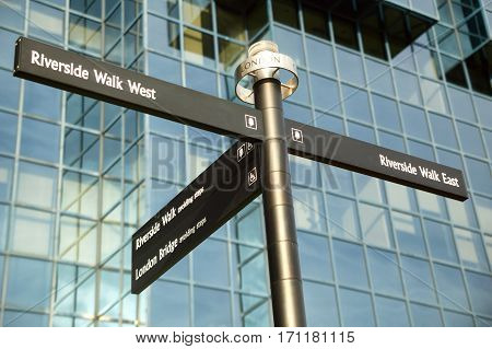 London, UK, November, 4 2007 : Street signpost giving east and west directions to the Thames Path Riverside Walk