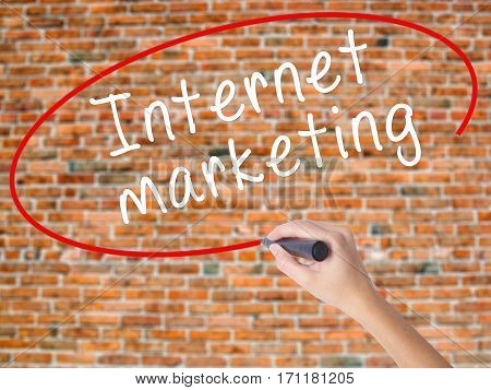 Woman Hand Writing Internet Marketing With Black Marker On Visual Screen