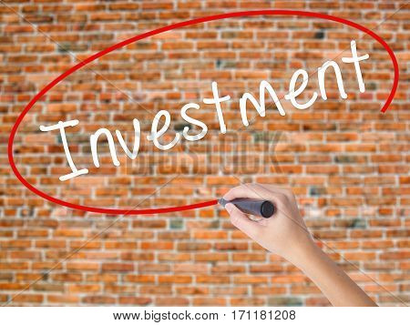 Woman Hand Writing Investment With Black Marker On Visual Screen