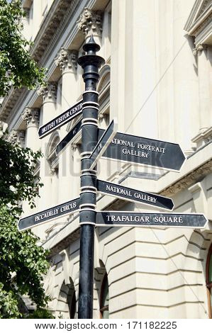 Street signpost giving directions to National Gallery, Trafalgar Square and Piccadilly Circus in London, England, UK