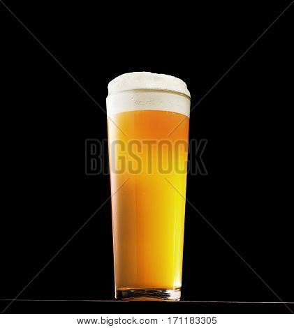 Wet Glass of fresh beer isolated on black background. With clipping path