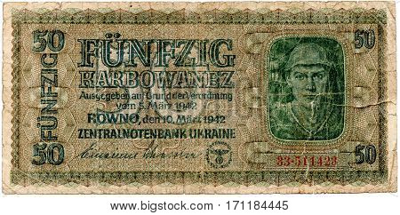 The old worn-out banknotes of the German 1942. Isolated on a white background. Currently not used.