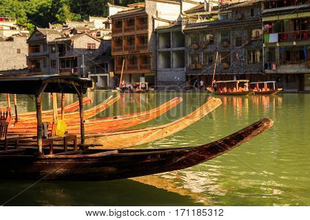Photo of Ancient City Fenix in China. Historic Asian Scenery with Water Canals, Wooden Houses, Gondola Boats