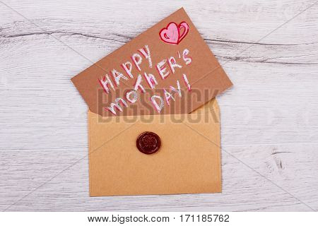 Mother's Day card on envelope. Envelope with seal. Send mother best greeting letter. Relax and enjoy the day.