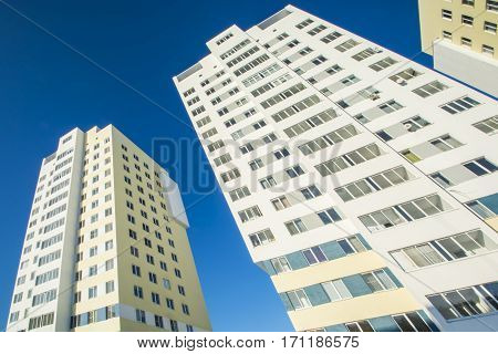 The facade of the new residential buildings against the sky .