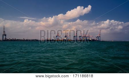 Panorama of Djibouti port with ships and cargo crane