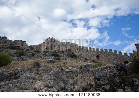Castle walls of Alanya with blue sky and clouds