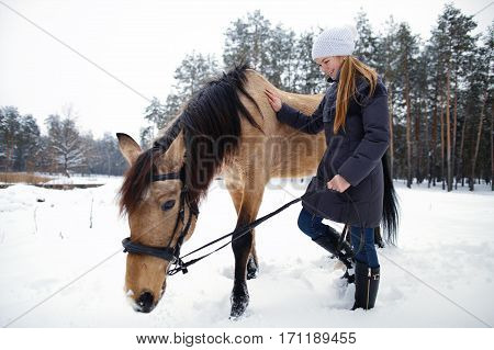 Lovely Girl With His Beloved Horse In A Snowy Forest. Walk In Nature With Fresh Air