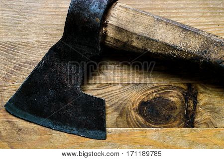 Old Metal Ax On A Wooden Surface.