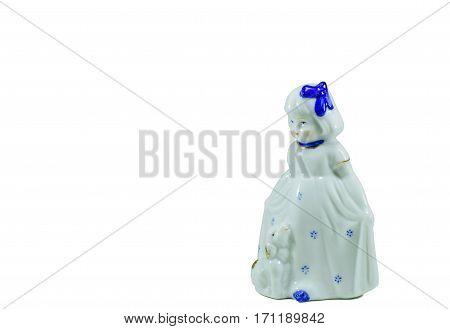 Isolated Porcelain Figurine Of A Little Girl.