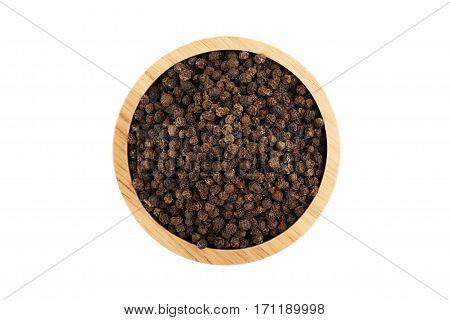 Black Peppercorns In Wooden Bowl