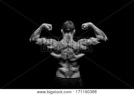 Handsome Bodybuilder Man With Muscular Body Training And Posing