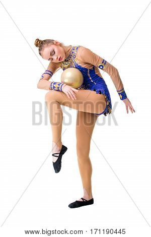 teenager doing gymnastics exercises with gymnastic ball. The girl in a blue dancing suit. isolated