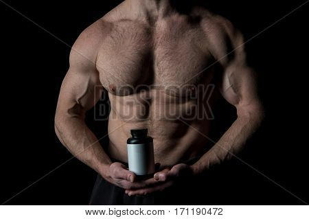 Handsome Sexy Athlete Man With Muscular Body Holds Plastic Jar Or Container