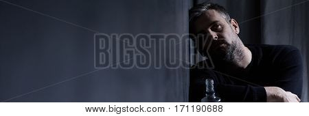 Depressed Man With Glass Bottle