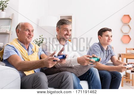 Male Generations Playing Game Together