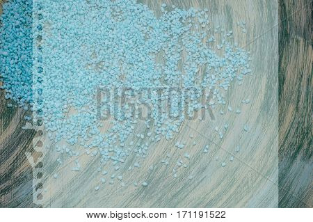 Blue Scattered Gravel On Swirling Streams Background With A Place For An Inscription.