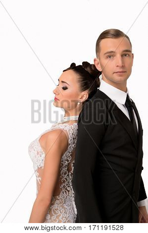 young couple of handsome businessman or gentleman guy in black formal suit of jacket and tie with pretty brunette woman or sexy girl with red lips on cute face in wedding dress isolated on white