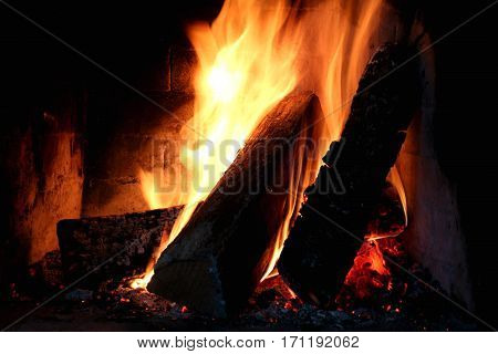 A fire in the fireplace. Bright,hot fire in the fireplace. Looking at the fire and bask near it is a pleasant experience.