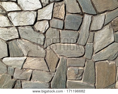 Closeup of an old stone wall (background)