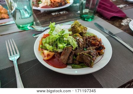 Table served for dinner with boiled beef prepared in tradional manner with vegetables