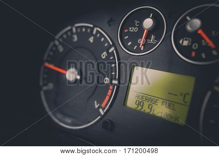 Close up image of a car's dashboard indicating a very high fuel consumption.