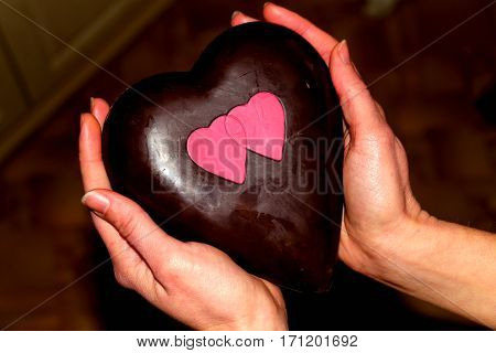 Chocolate dessert. The dessert of dark chocolate in the shape of a large heart. Chocolate fresh,tasty,very pleasant to the taste.