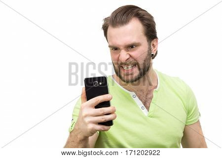 The photo depicts a man with a phone on a white background
