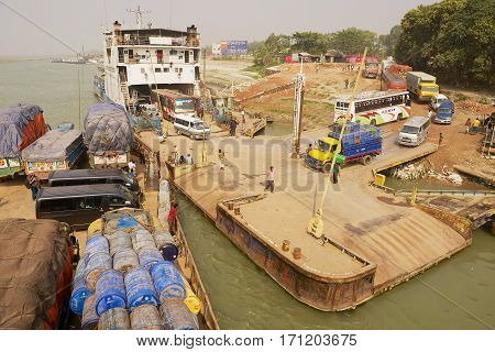 CHHOTA DHULANDI, BANGLADESH - FEBRUARY 19, 2014: View to the ferry pier from the arriving ferry boat in Chhota Dhulandi, Bangladesh. Ferry is a very important way of transportation in Bangladesh.