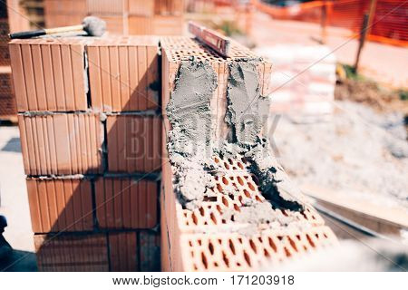 Industrial Building Construction Site. Details Of Exterior Brick Walls And Cement
