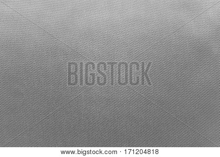 the textured background of fabric or textile material of faded gray