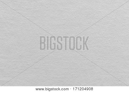 the textured background of cotton fabric or textile material of white color
