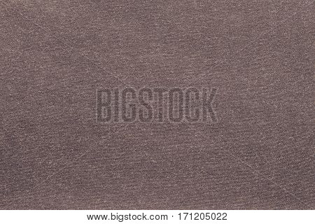 background and texture of knitted or woolen fabric of monotonous brown color