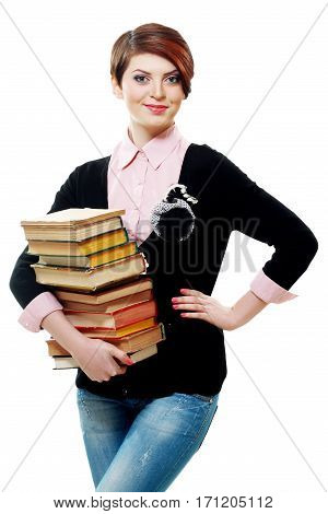 A smiling woman holding books isolated on white