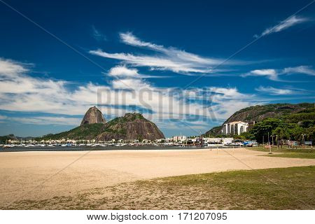 View of the Sugarloaf Mountain From Botafogo Beach in Rio de Janeiro, Deep Blue Sky With Clouds