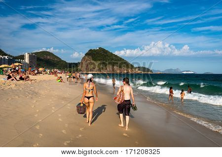 Rio de Janeiro, Brazil - January 27, 2017: People walking in Copacabana beach at the end of the day.