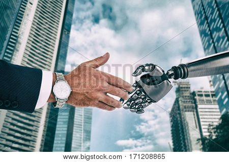 Businessman in suit clenching fists against city