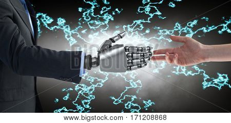 Cropped hand of woman against cropped image of businessman with robotic arm