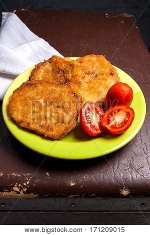 Potato Pancakes With Meat And Tomatoes On Green Plate In Belarusian Style On Dark Background.