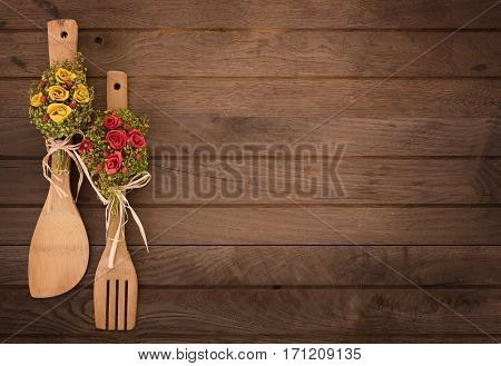 Decorative kitchen utencils on old wooden table with space for text