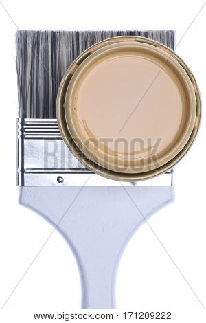 Paintbrush and Can Lid with Creme Color Paint Isolated on White Background, Top View