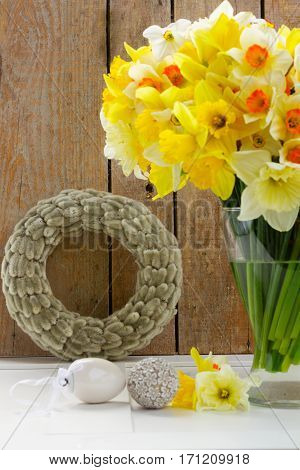 Easter catkins wreath with eggs and daffodils flowers