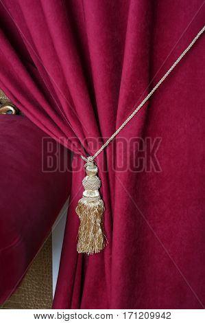 beautiful red curtain with tassel in theater.