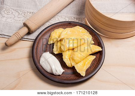 Fresh Boiled Varenyky Or Dumpling With Cottage Cheese Or Curd On Clay Plate And With Sour Cream On W