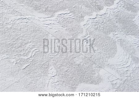 White textured background, snow surface wavy pattern created by winter wind, nature abstraction