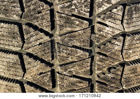 Dirty winter tyre tread close up background