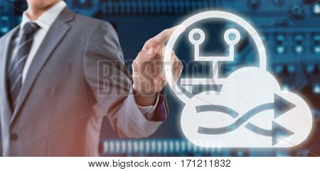 Midsection of well dressed businessman pointing against blue electronic circuit