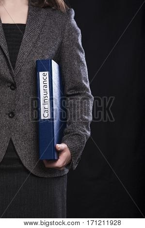 Office manager with blue folder named Car insurance